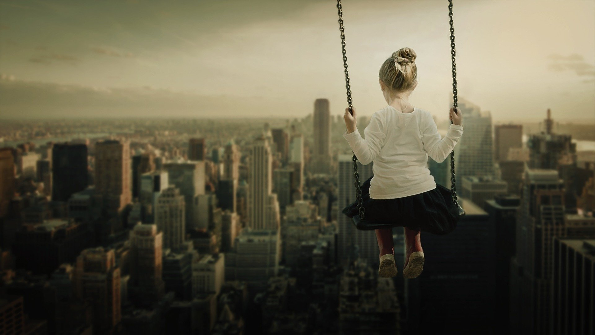 girl-sitting-on-swing-overlooking-city-dream.jpg