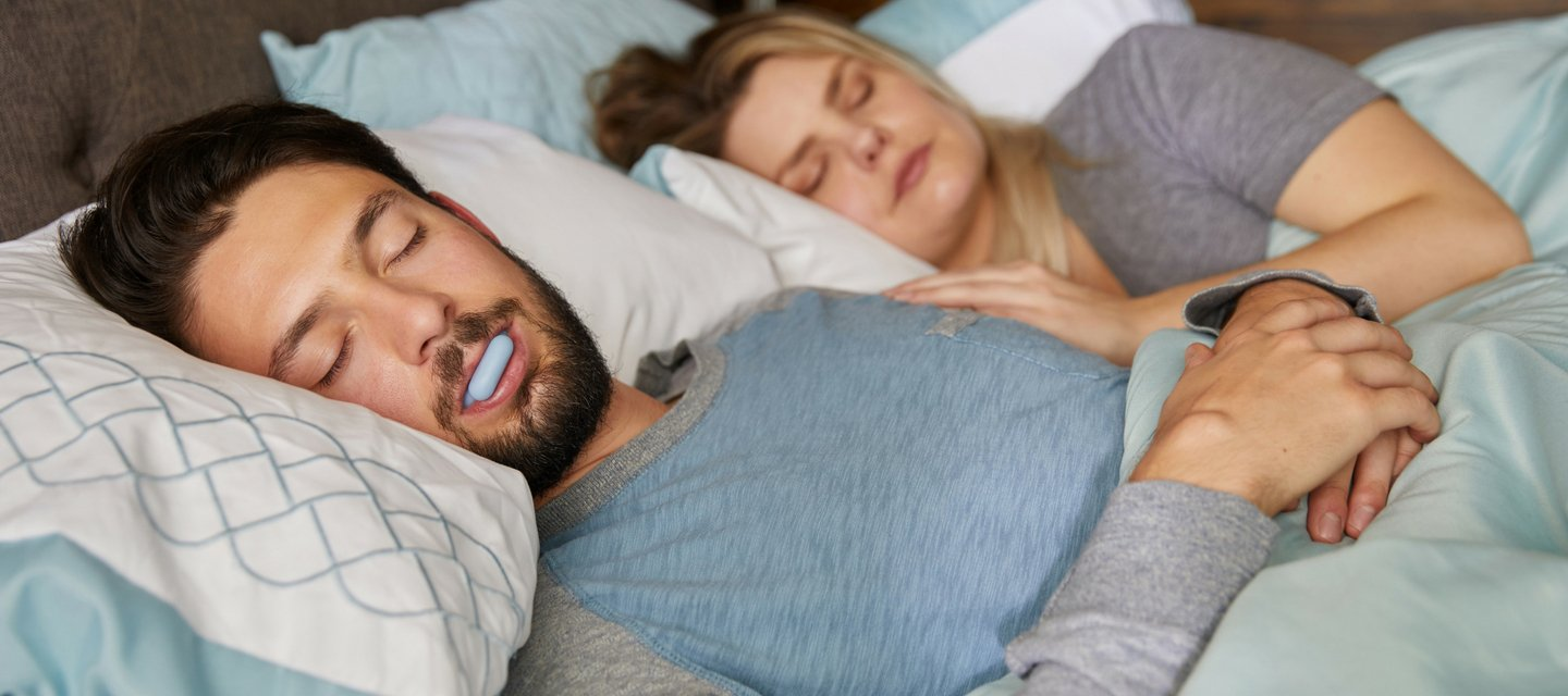 Couple Sleeping with Mouth Guard to Prevent Snoring