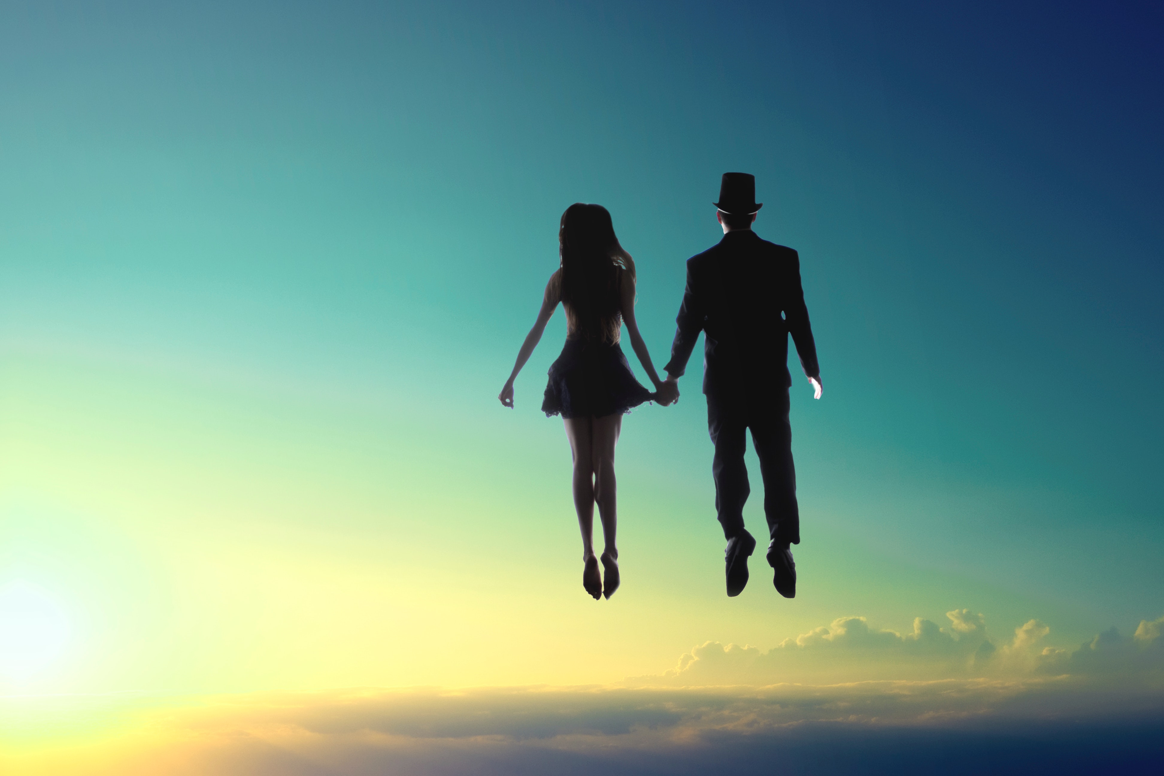 man-and-woman-floating-on-sky-in-a-dream.jpg